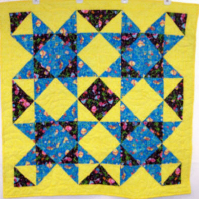 Child�s Quilt. Large stars. Top & backing are constructed using quality 100% cotton, batting is low loft polyester. Machine pieced and machine quilted by Linda Monasky <br />