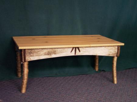 Coffee Table-Pine top was made from a log recovered from a mill pond; it was put in the pond after the hurricane of 1938.Table designed & built by Joe Monasky