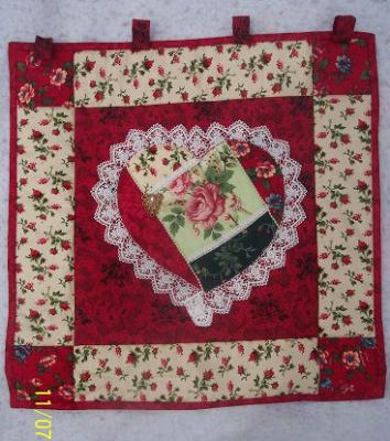 This crazy heart was made using an Eleanor Burns Pattern, 100% cotton fabric & embellishments.Machine pieced & machine quilted by Linda Monasky.