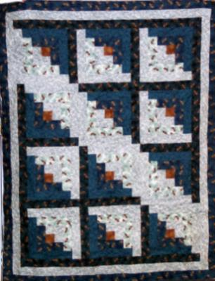 "Log Cabin Lap Quilt with matching 14"" pillow. Both quilt and pillow were made with Gronola Girl 100% cotton(outdoor) prints,batting is low loft polyester.Machine pieced by Linda Bixby and machine quilted by Linda Monasky. <br />$165.00 for the set"