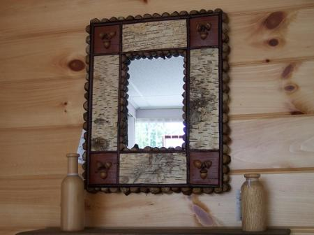 This mirror is surrounded by birch bark white side up and reverse side (brown)in the coners. With acorns & twigs to make it one of a kind by Mike Kazlo