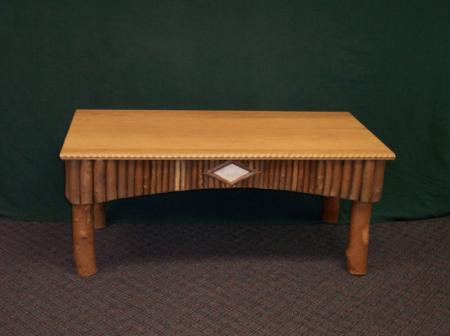 Oak top coffee table with twig sides and white birch bark detail.  $995