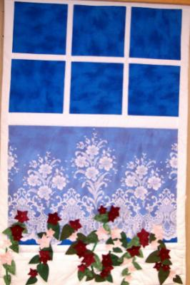 Wallhanging window features a flower box. Top & backing are constructed of quality 100% cotton, batting is low loft polyester.With polyester lace curtain. Machine pieced and machine quilted by Linda Monasky  <br />